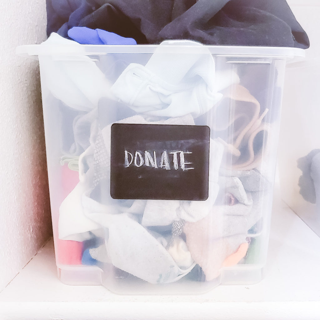 declutter and organize kids closet hack - create a dedicated donate bin