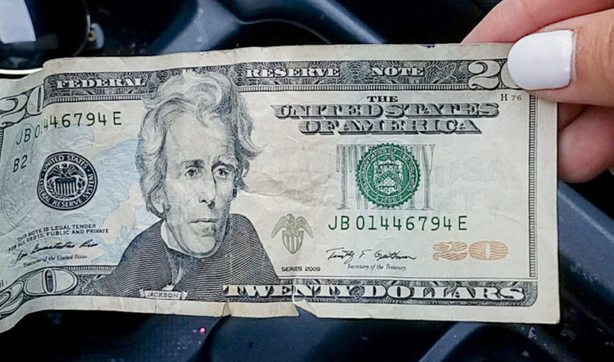 how to quit buying things to save money - twenty dollar bill
